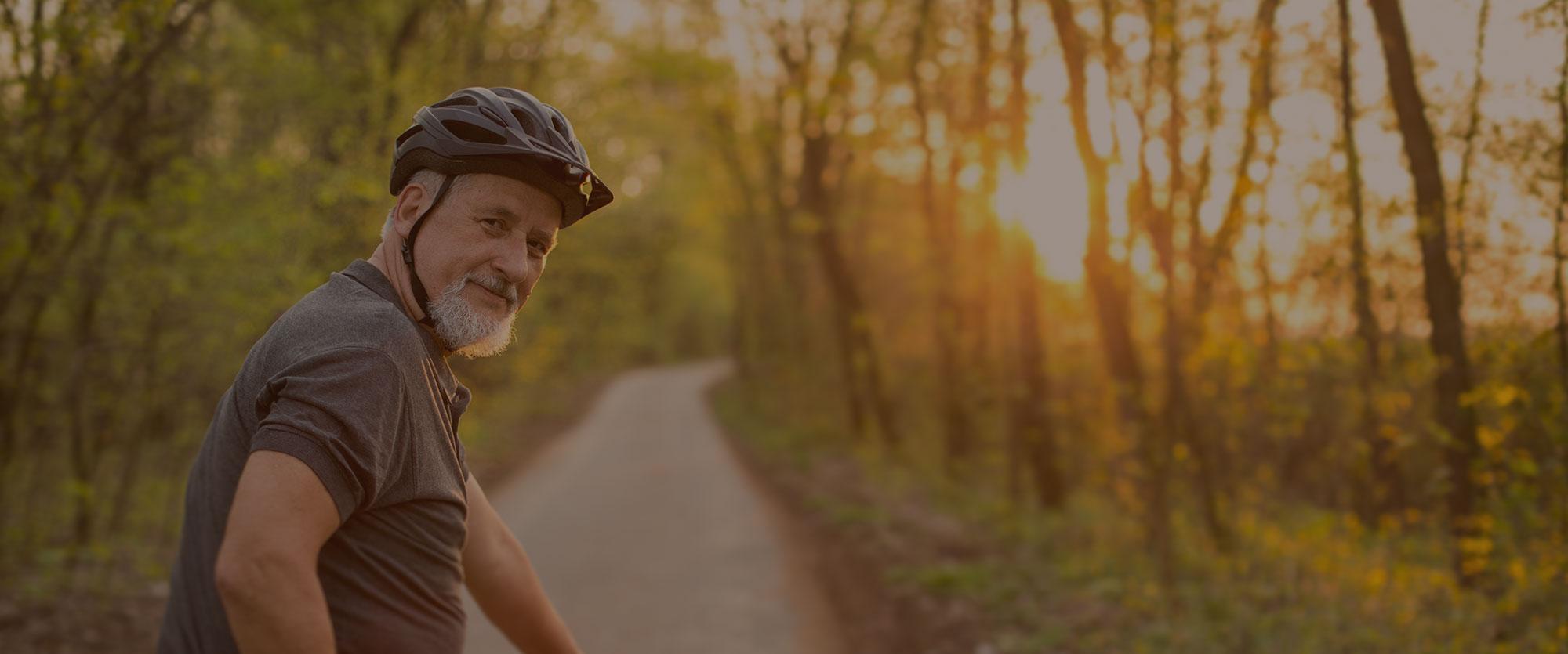 Man biking on wooded trail